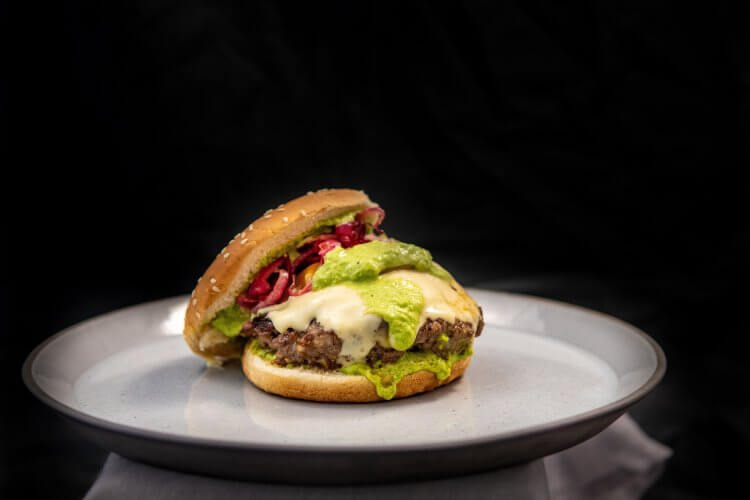 Shows the assembled burger on a black background